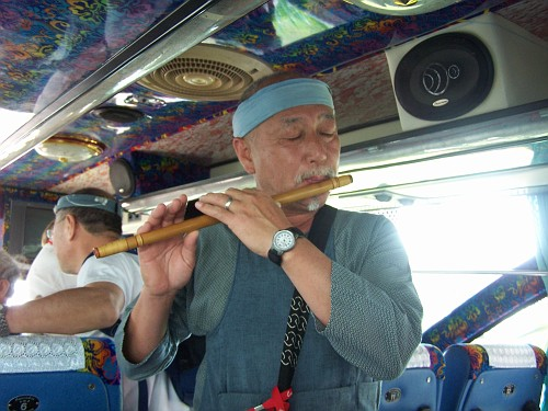 Toki-san demonstrates his skills on the Japanese flute as we head for th field.