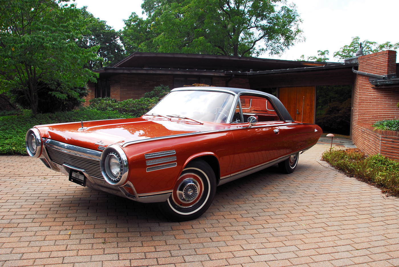 08 1963 Chrysler Ghia Turbine Car front wide-angle view at sixties-era modern home