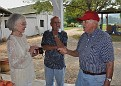 Rodney McGlasson {right} meets Toni at his fruit farm on Kentucky 8. Mr. McGlasson was one of the first on the scene of the American Airlines accident and assisted in bringing survivor Isreal Horowitz to safety from the hillside.