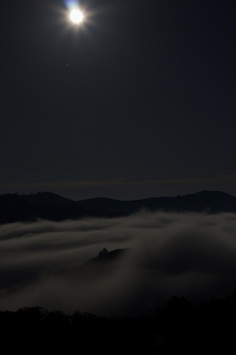 Moonrise above the clouds