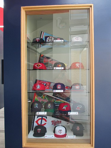 Collection of caps from Twins organization teams.