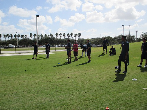 Minor league players working out and rehabbing on the agility field.