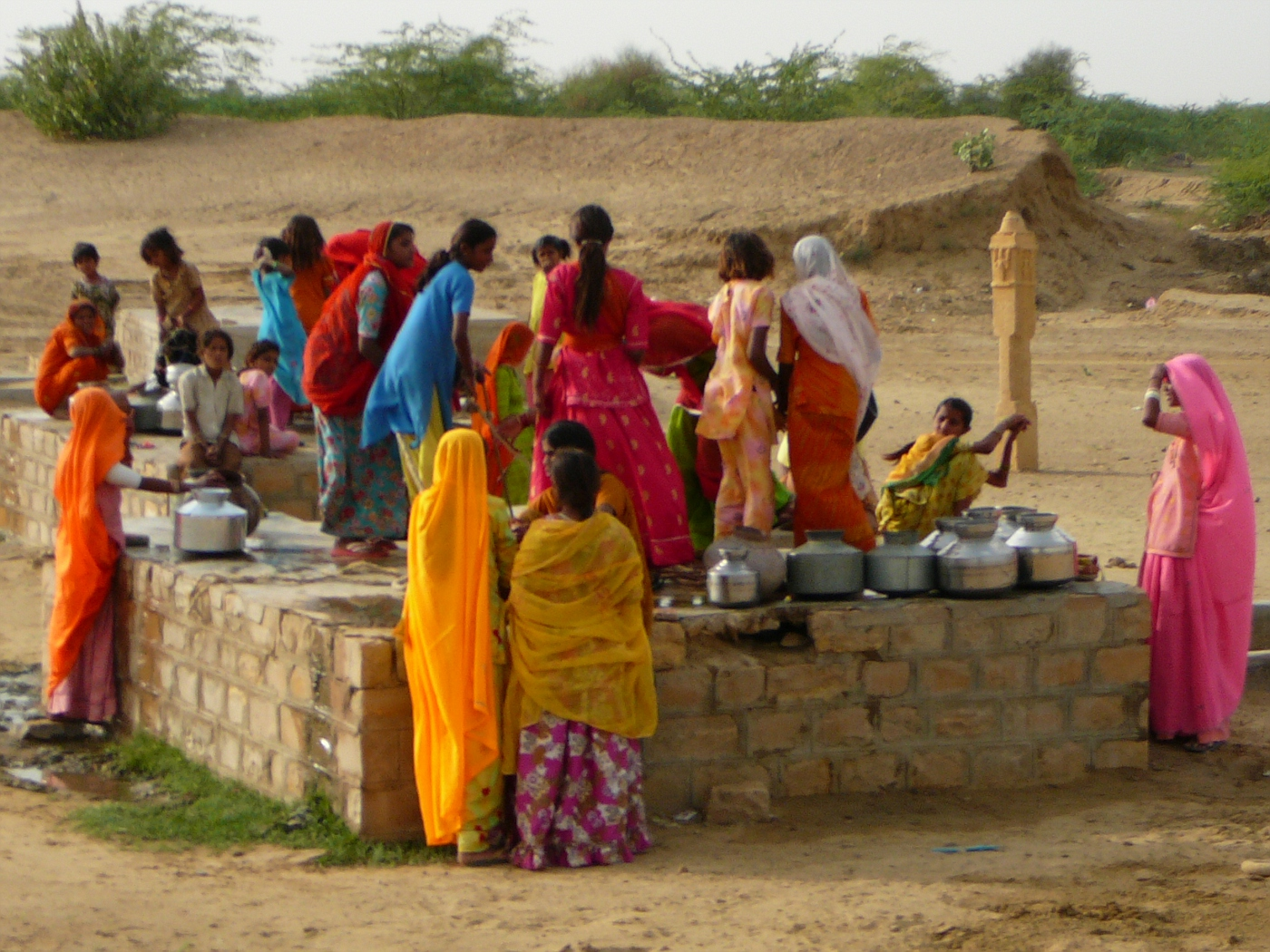 Women getting water from local well